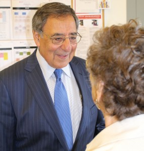 Secretary Panetta talks with a volunteer about reading
